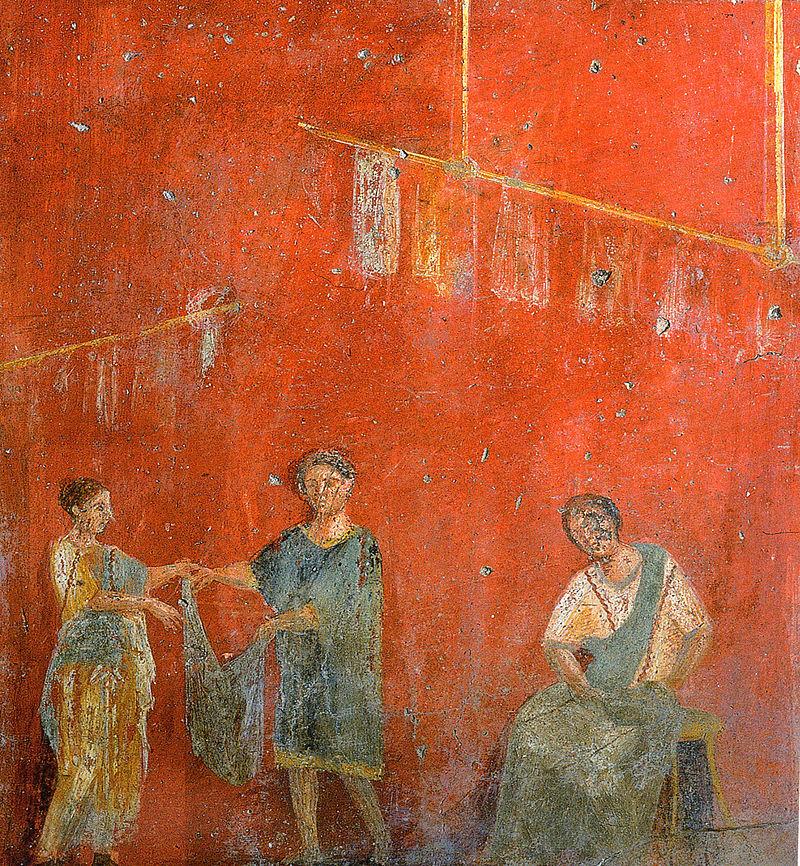 Dones treballant al costat d'un home en una botiga de tint (fullonica), en una pintura mural de Pompeia